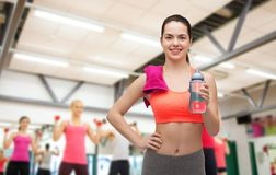 Sporty woman with towel and water bottle Royalty Free Stock Photos