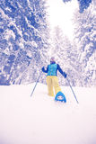 Sporty woman traveler on snowshoes resting Stock Photo