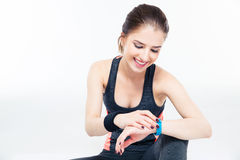 Sporty woman using smart watch Royalty Free Stock Photography