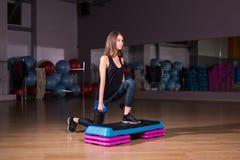 Sporty woman using step platform Royalty Free Stock Image