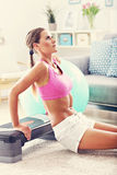 Sporty woman using step platform at home Stock Photography