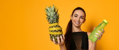 Sporty woman waist with measure tape and pineapple royalty free stock photos