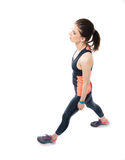 Sporty woman walking over white background Royalty Free Stock Photo
