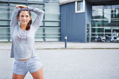 Sporty woman warming up before running Royalty Free Stock Image