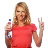 Sporty woman with water bottle Royalty Free Stock Images