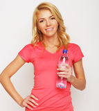Sporty woman with water bottle Stock Photography