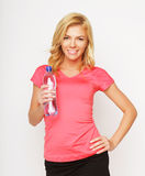 Sporty woman with water bottle Stock Image