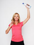 Sporty woman with water bottle Stock Images