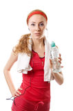Sporty woman with water, towel and headphones Royalty Free Stock Image