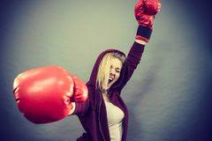 Woman winner wearing boxing gloves Stock Image