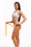 Sporty woman on white background Stock Images