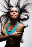Sporty woman with wind in hair Royalty Free Stock Image
