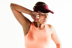 Sporty woman wiping away sweat Stock Images