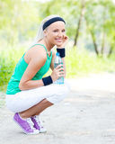 Sporty woman wit water Royalty Free Stock Image