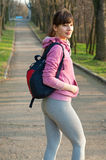 Sporty woman witha backpack royalty free stock photos
