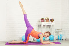 Sporty woman is working out Royalty Free Stock Image