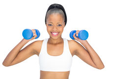 Sporty woman working out with dumbbells Royalty Free Stock Photos