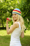 Sporty woman is working out outdoor. Royalty Free Stock Images