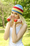 Sporty woman is working out outdoor. Royalty Free Stock Photo