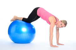 Sporty woman working out with a pilates ball Stock Photography