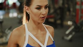 Sporty woman workout on training simulator in crossfit gym 4K.  stock video footage