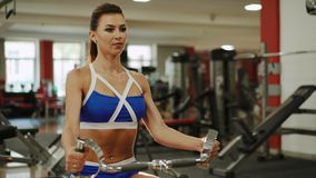 Sporty woman workout on training simulator in crossfit gym 4K.  stock footage