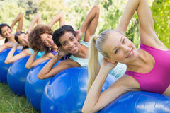 Sporty women balancing on pilates Stock Image