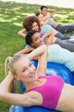 Sporty women balancing on pilates Royalty Free Stock Photo