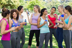Sporty women communicating at park Royalty Free Stock Images