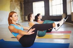 Sporty women doing abdominal crunches at workout. Group workout, activity, healthy lifestyle, sport, weight loss, tabata, endurance, perfect shape. Sportswomen stock image