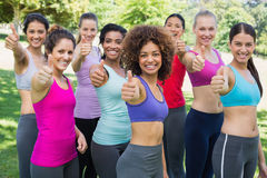 Sporty women gesturing thumbs up in park Royalty Free Stock Photography