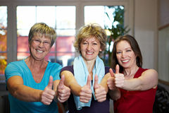 Sporty women holding thumbs up Stock Photos