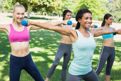 Sporty women lifting hands weights Stock Images