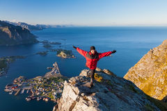 Sporty women on the top of mountain over ocean Royalty Free Stock Image