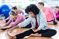 Sporty women touching toes Stock Photo