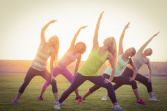 Sporty women warming up during fitness class Royalty Free Stock Image
