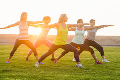 Sporty women warming up during fitness class Stock Images