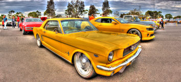 Sporty yellow Ford Mustang Royalty Free Stock Photos