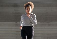 Sporty young black woman running outdoors Royalty Free Stock Photos
