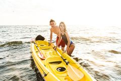 Sporty young couple kaying together stock image