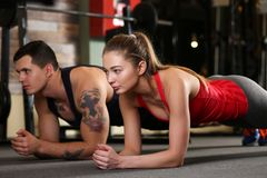 Sporty young couple work out together Royalty Free Stock Photo
