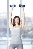 Sporty young female doing fitness training with dumbbells Royalty Free Stock Image
