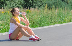 Sporty young female drinking Royalty Free Stock Photography
