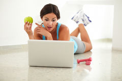 Sporty young female surfing the web Royalty Free Stock Image