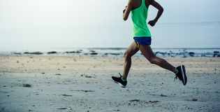 Itness woman running on beach. Sporty young fitness woman running on beach Stock Photography