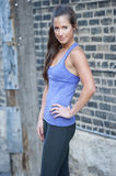 Sporty Young Girl. A beautiful young, sporty and happy girl posing outdoors in yoga pants Stock Images