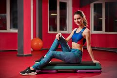 Sporty young girl in fitness club stock photo