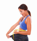 Sporty young lady measuring weight loss Stock Photo