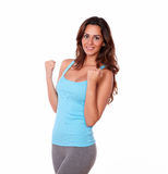 Sporty young lady standing and smiling Royalty Free Stock Photography