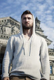 Sporty young man with beard in front of the Reichstag. Sporty young man with Hoodie front Reichstag Berlin Royalty Free Stock Photography